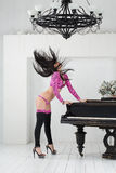 Headbanging go-go dancer in pink costume Royalty Free Stock Images
