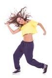 Headbanging modern style dancer. Posing on studio background Stock Photos