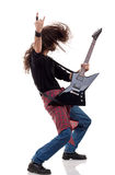 Headbanging rocker. Plays guitar over white background Royalty Free Stock Images