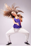 Headbanging woman dancer. Standing on a leg in a full of energy dance move and screaming Royalty Free Stock Photo