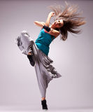 Headbanging woman dancer screaming. Headbanging woman dancer standing on a leg in a full of energy dance move and screaming Royalty Free Stock Photos