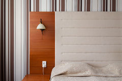 Headboard and bed in a clean hotel room Royalty Free Stock Photos