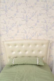 Headboard of a single bed with a throw pillow. Modern classics w Stock Photography