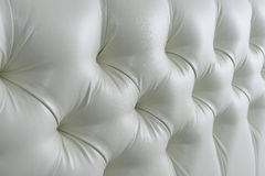 Headboards. Quilted leather headboard. white leatherette Stock Photos
