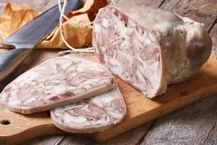 Headcheese chopped slices on kitchen board Royalty Free Stock Images