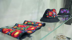 Headdress in The Boutique. Hats Iie On a Glass Shelf in The Boutique stock video