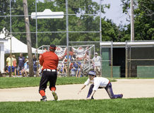 Headed Back to Second. Spring Lake, NJ USA--July 11, 2015 Fans watch as a base runner heads back to second base  in a baseball game played using 1915 rules Stock Photography