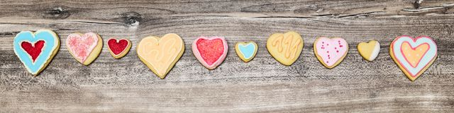 Header, colorful Heart cookies in a line, concept Mother´s day. Header, colorful Heart cookies in a line, concept Mother´s day or Valentine´s day Royalty Free Stock Photo