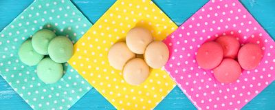 Header, colorful macarons or biscuits on different dotted napkin. S, topview Royalty Free Stock Image