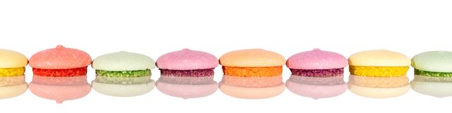 Header, colorful various cookies or macarons, cutout on white ba stock photo