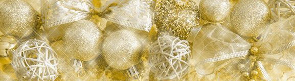 Header with golden christmas decoration and sparkling background. Header with golden christmas decoration, sparkling background, panoramic format Stock Photo