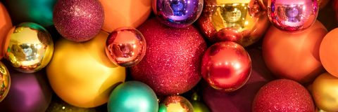 Header, lots of colorful christmas balls. Festive xmas background Royalty Free Stock Photos