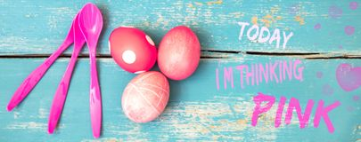 Header, red dyed eggs and spoons on wooden table, text tody i am. Header, red dyed eggs and spoons on blue wooden table, text tody i am thinking pink Royalty Free Stock Photo