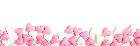Header, white and pink sugar hearts with copyspace. Concept sweet love Royalty Free Stock Photo