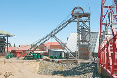 Headframe at Big Hole, Kimberley. Headframe (also known as a gallows frame, winding tower, hoist frame, pit frame, shafthead frame, headgear, headstock or Royalty Free Stock Images