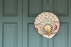Headgear. Hanging on the wooden door Royalty Free Stock Photo