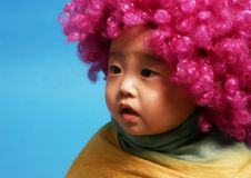 Headgear. Baby boy wearing a pink headgear Stock Images