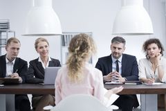 Headhunters examining potential employee. Headhunters examining a potential employee during job recruitment in corporation Stock Photography