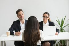 Headhunters interviewing female job candidate royalty free stock image