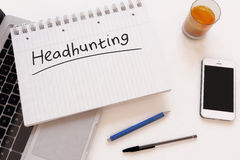 Headhunting. Handwritten text in a notebook on a desk - 3d render illustration Stock Photos