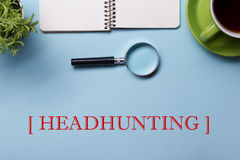 Headhunting Hiring HR Human Resources Position Concept. Office supplies on desk table top view. Notepad, magnifying Stock Photography