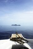Heading. A boat heading to an island Royalty Free Stock Images