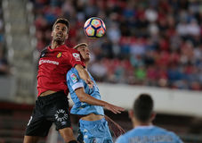 Heading the ball, Real Mallorca against Girona soccer clubs. Real Mallorca player Salomao and Felipe Sanchon fight to head the ball during their second division Stock Images