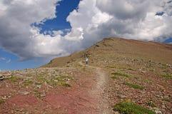 Heading down an alpine trail Royalty Free Stock Photos