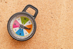 Heading East. With (toy) Compass On Cork royalty free stock images