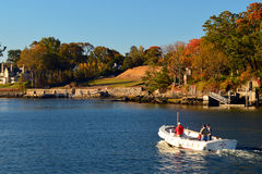 Heading out. A small boat is heading for open waters Stock Image