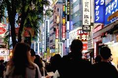 Heading into Shinjuku. Crowd walking through Shinjuku Ward in Tokyo, Japan Royalty Free Stock Photos