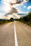 Heading into the sunset on an empty road Royalty Free Stock Photo