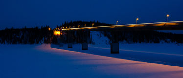 Heading to Fairbanks. Truck crossing the Yukon river leaves a light trail Stock Photo