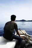 Heading to Island. A man in a boat heading to island Stock Photo