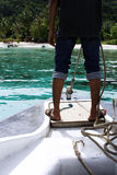 Heading to Shore. A man in a boat heading to shore Stock Images