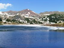 Heading up Beartooth pass, Montana Snow in June. Snow capped mountains and thawing water this is a beautiful June day riding up Beartooth Pass in Montana royalty free stock images