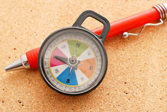 Heading West. With A Toy Compass Stock Image
