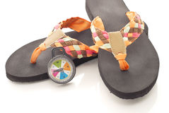 Heading West For Summer. Sandals with Compass Pointing West Royalty Free Stock Photography