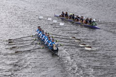 Headington (left) RMY Queens (Right) races in the Head of Charles Regatta Women's Youth Eights Stock Photos