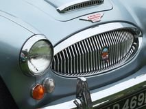 Headlamp and bumper of a blue Austin Healey 3000 Sports car at the Annual Hebden Bridge Vintage Weekend Vehicle Show. Hebden Bridge, West Yorkshire, England royalty free stock photos