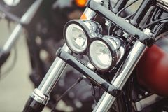 Headlamp of a classic motorcycle, stylish front view, close-up Stock Image