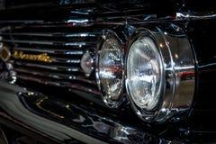 Headlamp of full-size car Pontiac Bonneville, 1960. STUTTGART, GERMANY - MARCH 04, 2017: Headlamp of full-size car Pontiac Bonneville, 1960. Close-up. Europe`s Royalty Free Stock Photos