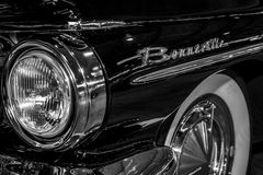 Headlamp of full-size car Pontiac Bonneville, 1960. STUTTGART, GERMANY - MARCH 04, 2017: Headlamp of full-size car Pontiac Bonneville, 1960. Close-up. Europe`s Stock Photos