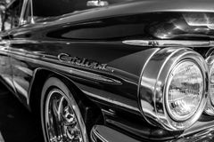 Headlamp of the full-size car Pontiac Catalina, 1960. BERLIN - MAY 06, 2018: Headlamp of the full-size car Pontiac Catalina, 1960. Black and white. Oldtimertage Stock Photos