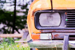 Headlamp and grille of rusted car closeup Royalty Free Stock Photos
