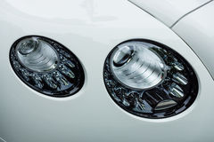 Headlamp of a luxury car Bentley Continental GTC, close-up Royalty Free Stock Photo