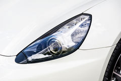 Headlamp on a modern white  car Royalty Free Stock Image