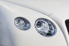 Headlamp on a modern white expensive  white   car Stock Images