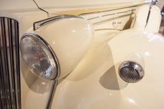 Headlamp and mudguard in a classic cornsilk car Stock Photos