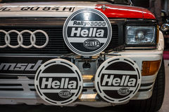 Headlamp of the road and rally car Audi Quattro, closeup. Royalty Free Stock Image